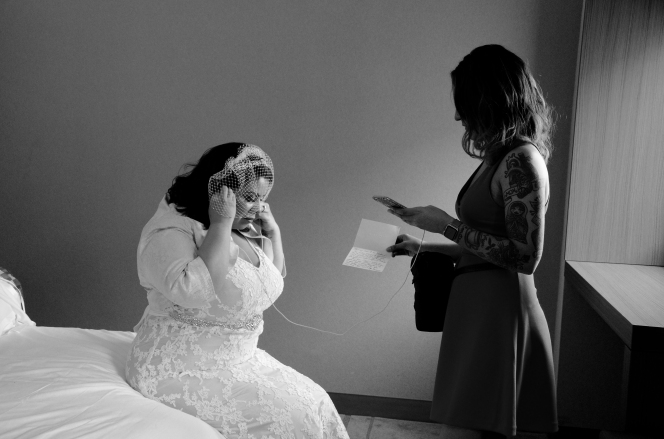 Bride to be listens to a message from her fiancé before heading to the alter.