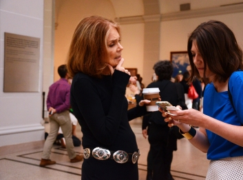 Gloria Steinem, feminist, author, and political activist chat and pose for pictures with young female journalist in the Beaux Arts Court.