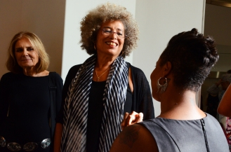 Angela Davis meets with guest and the media before the awards ceremony.